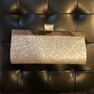 Silver clutch with detachable cross body chain